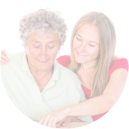 caregiver assisting patient in writting