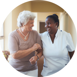 happy caregiver and patient looking at each other