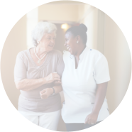 caregiver holding the hands of a happy patient
