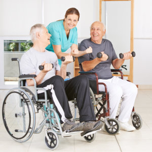 physical therapist assisting senior patients